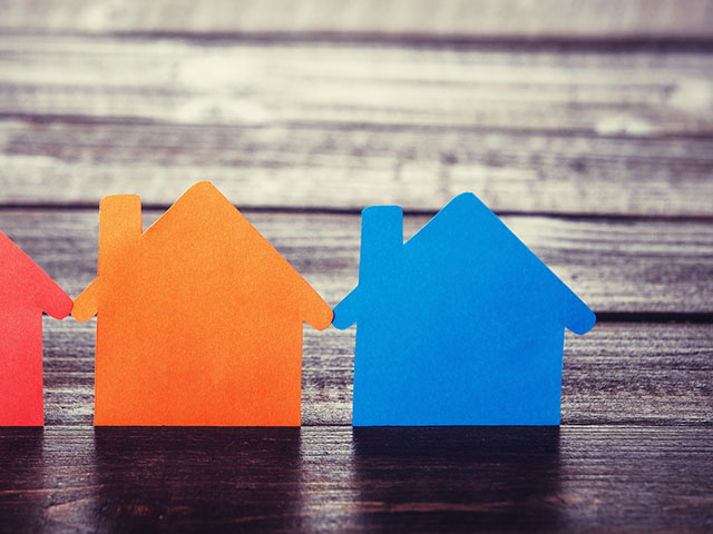 bigstock-Three-Paper-Houses-On-Wooden-Table
