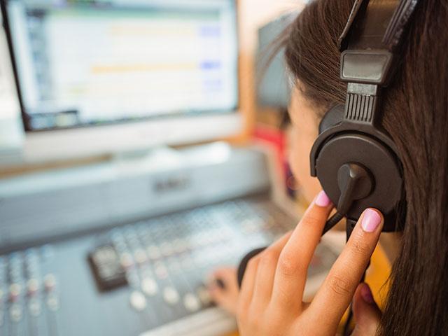 bigstock-University-student-mixing-audi